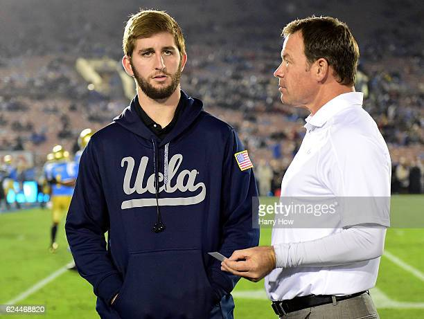 Injured quarterback Josh Rosen of the UCLA Bruins and Head Coach Jim Mora on the sidelines before the game against the USC Trojans at Rose Bowl on...