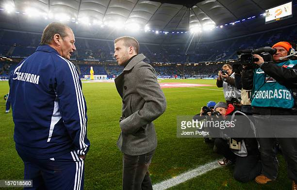 Injured Rafael van der Vaart of Hamburg and Huub Stevens, head coach of Schalke, chat prior to the Bundesliga match of Hamburger SV and FC Schalke 04...
