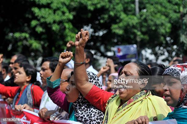 Injured Rana Plazas Garment workers protest and form human chain in front of press club in Dhaka asking for their medical allowance from their...