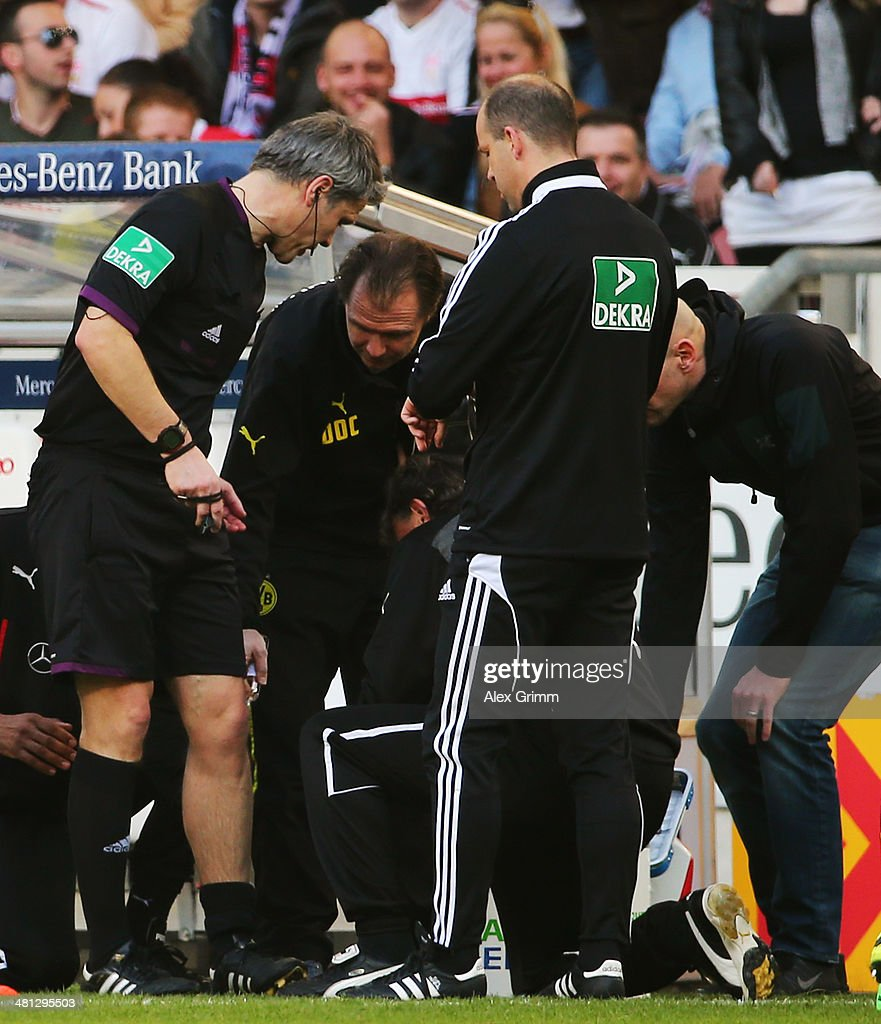 Injured referee Michael Weiner receives treatment during the Bundesliga match between VfB Stuttgart and Borussia Dortmund at Mercedes-Benz Arena on March 29, 2014 in Stuttgart, Germany.