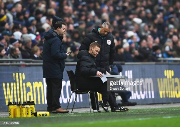 Injured referee Mike Jones is given assistance as he operates as fourth official during the Premier League match between Tottenham Hotspur and...