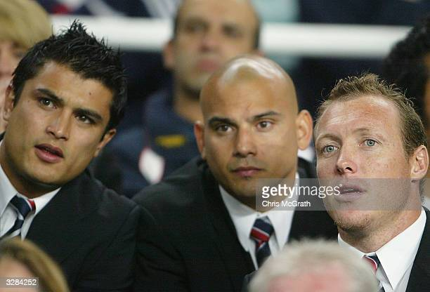 Injured Roosters Craig Wing Shannon Hegarty and Craig Fitzgibbon watch on from the bench during the NRL round five match between the Sydney Roosters...
