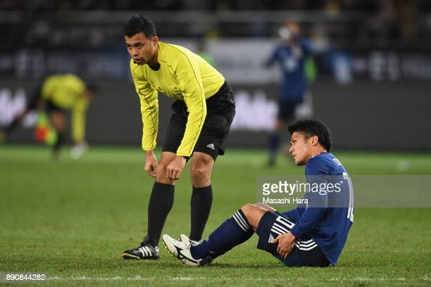 Injured Ryota Oshima of Japan is seen during the EAFF E1 Men's Football Championship between Japan and China at Ajinomoto Stadium on December 12 2017...