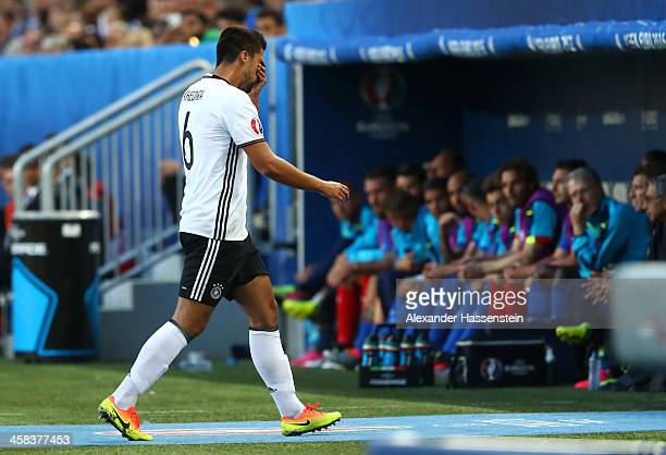 Injured Sami Khedira of Germany walks off the pitch after being replaced during the UEFA EURO 2016 quarter final match between Germany and Italy at...