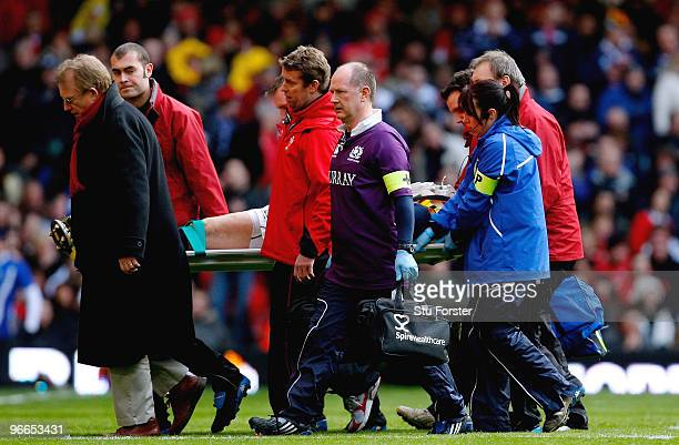 Injured Scotland player Thom Evans is stretchered off during the RBS 6 Nations Championship match between Wales and Scotland at the Millennium...
