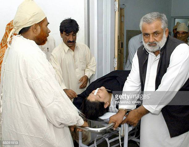 Injured Shiite Muslim woman Nargis Fatima is attended by medical staff as she is brought into a hospital in Quetta 18 July 2005 after being injured...