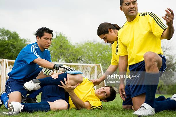 Injured Soccer Player Holding His Knee