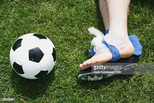 Injured soccer player with ice on ankle