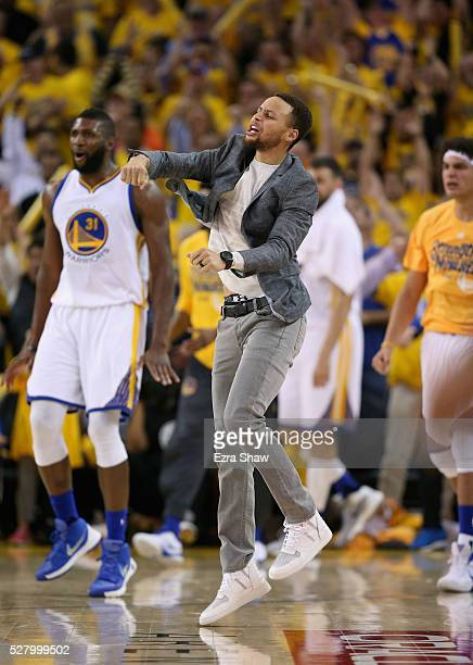Injured Stephen Curry of the Golden State Warriors reacts on the bench during their victory over the Portland Trail Blazers in Game Two of the...