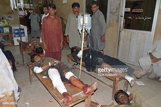Injured suicide blast victims lie on hospital tables after a suicide blast targeting a Shiites procession in the southern Pakistani city of Jacobabad...