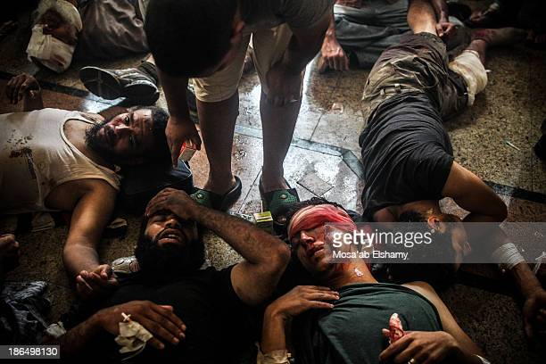 CONTENT] Injured supporters of ousted president Mohamed Morsi lay in a makeshift hospital at Rabaa Adaweya square during the violent dispersal of the...