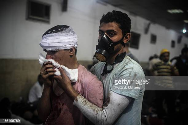 Injured supporters of ousted president Mohamed Morsi receive treatment at Rabaa Adaweya makeshift hospital during the violent dispersal of the camp...