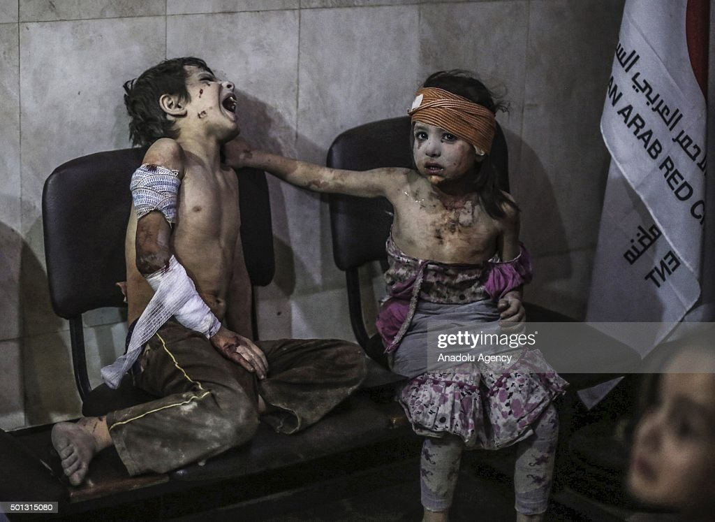 Injured Syrian kids are seen at a field hospital after Assad regime forces' airstrikes on a market in the opposition controlled Damascus suburb of Douma, Syria on August 22, 2015. At least 50 people were killed after a barrel bomb attack by Syrian regime forces on Saturday in Syrias Douma.