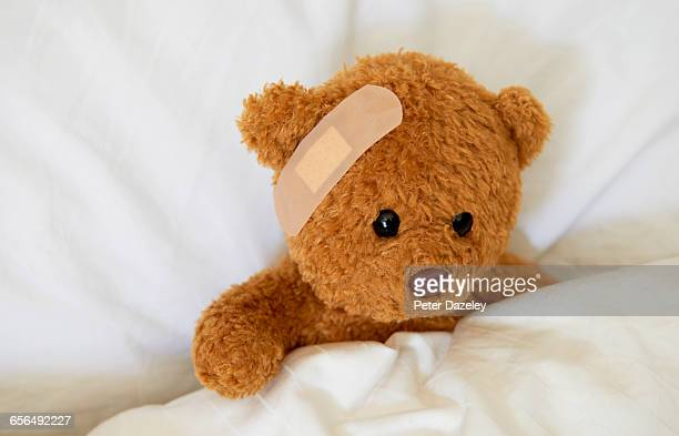 injured teddy bear with plaster - band aid stock pictures, royalty-free photos & images
