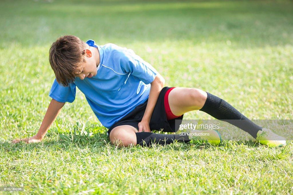 Injured teenage soccer player : Stock Photo