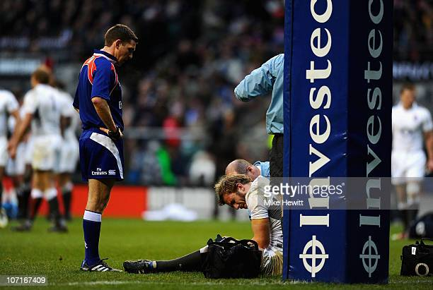 Injured Tom Croft of England after suffering a dislocated shoulder during the Investec Challenge match between England and South Africa at Twickenham...