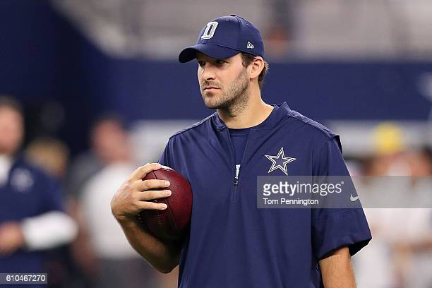 Injured Tony Romo of the Dallas Cowboys throws prior to a game against the Chicago Bears at ATT Stadium on September 25 2016 in Arlington Texas