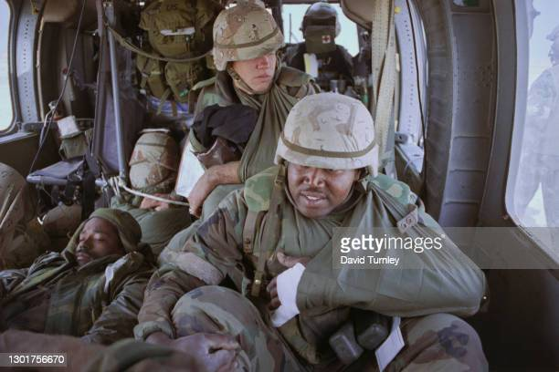 Injured United States military personnel in a Sikorsky UH-60 Black Hawk helicopter on their way to the 5th Mobile Army Surgical Hospital, during the...