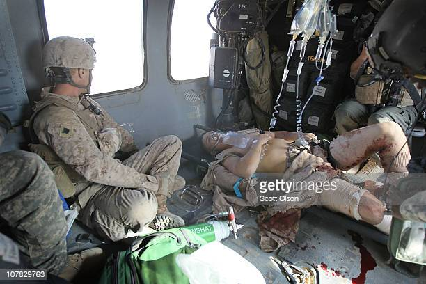 Injured US Marines David Hawkins of Parker CO and Dan Hall of Littleton CO are transported by a MEDEVAC helicopter September 24 2010 near Marja...