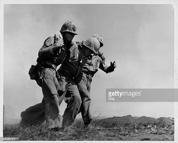 Injured US marines of the 4th Division at the Battle of Iwo Jima during World War Two Japan February 20th 1945