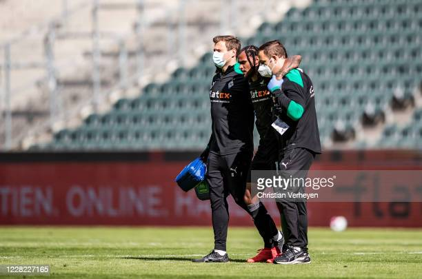 Injured Valentino Lazaro of Borussia Moenchengladbach leave the pitch during the PreSeason friendly match between Borussia Moenchengladbach and SpVgg...