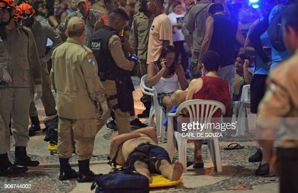 TOPSHOT Injured victims are assisted at Copacabana beach in Rio de Janeiro on January 18 2018 At least 11 people were injured by a car that drove up...