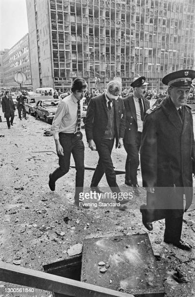 Injured victims are led away after the car bombing of the Old Bailey by the Provisional IRA in London, UK, 8th March 1973.