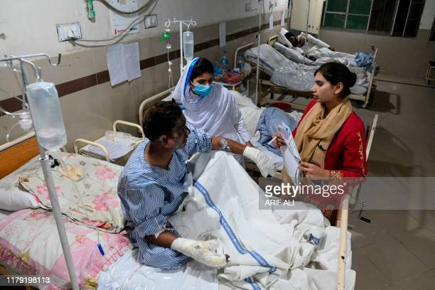 TOPSHOT Injured victims are treated at a hospital in Bahawalpur on October 31 after a passenger train caught on fire in Rahim Yar Khan in Punjab...