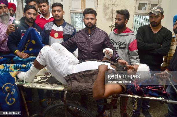 Injured victims being treated at Guru Nanak Dev Hospital in Amritsar after two men on a motorcycle reportedly threw a grenade at the Nirankari Bhawan...