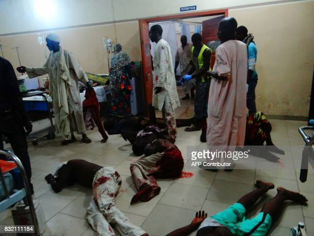Injured victims of a female suicide bomber lie on the floor awaiting medical attention as beds were no longer available at a Maiduguri hospital in...