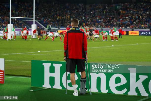 Injured Wales' full back Liam Williams watches his teammates warming up before the start of the Japan 2019 Rugby World Cup semifinal match between...