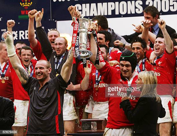 Injured Welsh Captain Gareth Thomas and match day Captain Michael Owen lift the Trophy after the RBS Six Nations International between Wales and...