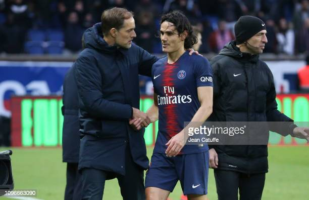 Injured while scoring his goal on a penalty kick Edinson Cavani of PSG talks to coach of PSG Thomas Tuchel while leaving the pitch during the french...