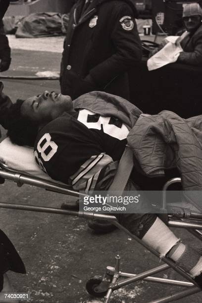 Injured wide receiver Lynn Swann of the Pittsburgh Steelers is taken from the field on a stretcher after sustaining a concussion during the AFC...
