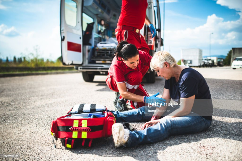 injured woman at the edge of the road : Stock Photo