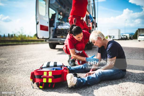 injured woman at the edge of the road