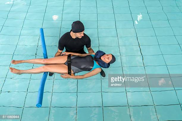 Injured woman doing physical therapy in the water