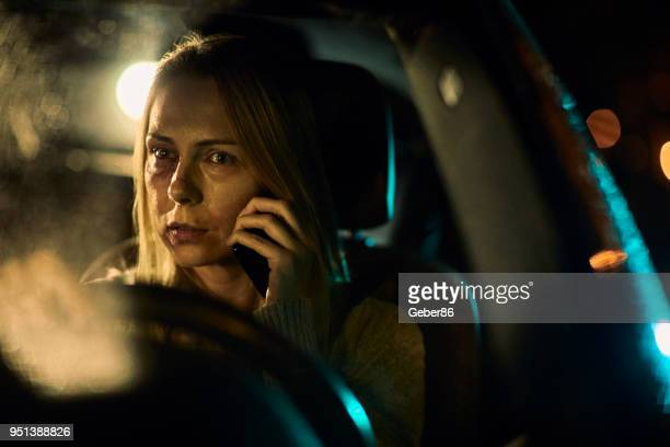 Injured woman talking on the phone