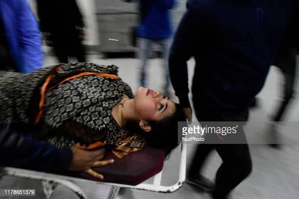 A injured women being taken to a local hospital for treatment in Srinagar Indian Administered Kashmir on 28 October 2019 Several civilians were...