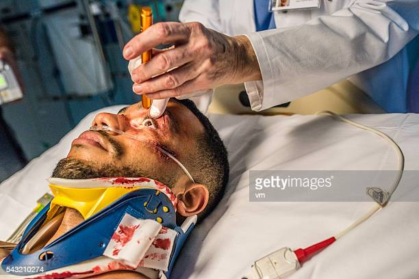 injured young man in er - eye injury stock pictures, royalty-free photos & images