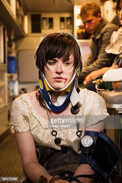 injured young woman in an ambulance - gory car accident photos stock pictures, royalty-free photos & images