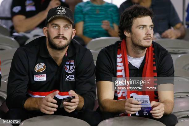 Injures St Kilda players Josh Bruce and Dylan Roberton sit in the stands during the round five AFL match between the St Kilda Saints and the Greater...