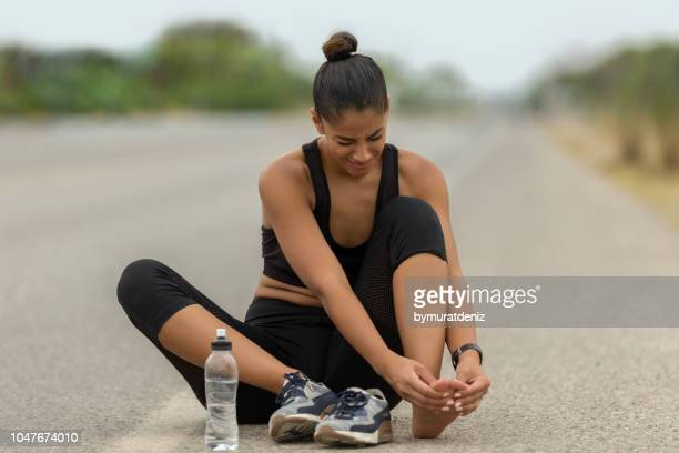 injury her foot on road - sprain stock pictures, royalty-free photos & images