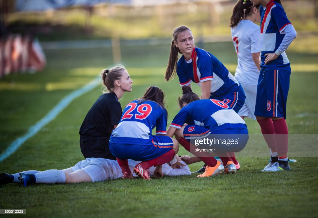 Injury on women's soccer match! : Stock Photo