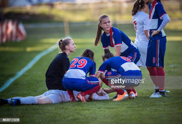 injury on women's soccer match! - personal injury stock photos and pictures