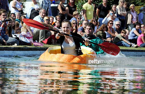 Inka Endrizzi paddles in a hollowed out pumpkin as she takes part in the German Pumpkin Boat Championship on September 16 2012 in Ludwigsburg western...