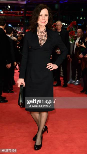Inka Friedrich arrives on the red carpet ahead of the awards ceremony of the 67th Berlinale film festival in Berlin on February 18 2017 / AFP /...
