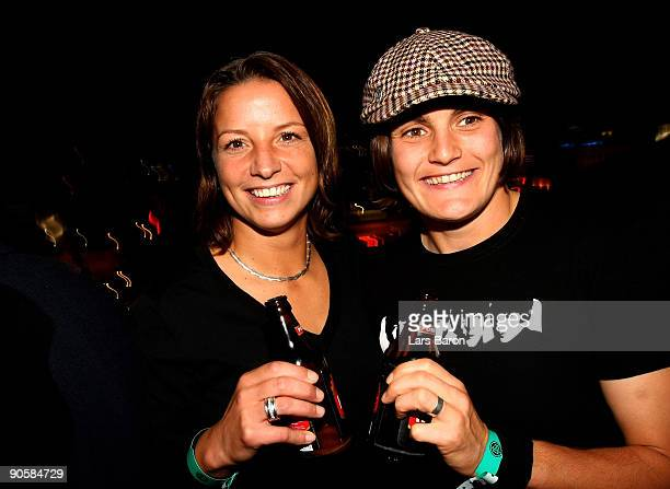 Inka Grings and goalkeeper Nadine Angerer of Germany celebrate during the UEFA Women's Euro 2009 Champions Party at the Tigers Club on September 10...