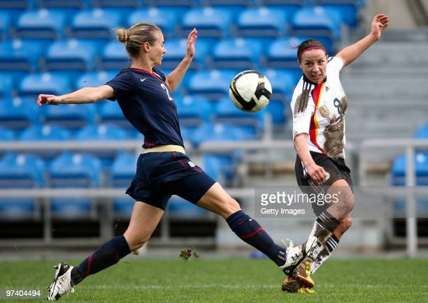 Inka Grings of Germany and Heather Mitts of USA battle for the ball during the Women Algarve Cup match between Germany and USA on March 3 2010 in...
