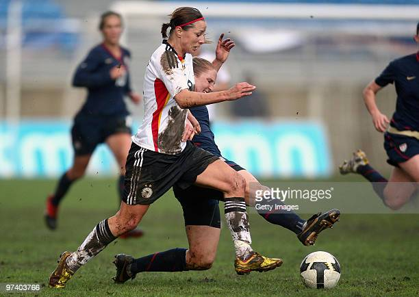 Inka Grings of Germany and Rachael Buehler of USA battle for the ball during the Women Algarve Cup match between Germany and USA on March 3, 2010 in...
